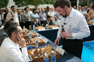 Pega CEO Alan Trefler simultaneously beating 19 out of 20 chess players while drinking beer.