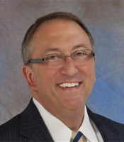 Thomas J. Gryp, President and CEO, Notre Dame FCU.