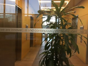 """""""We are innovative and continuously pursue excellence."""" Motto in frosted glass at CSAA Insurance Group headquarters."""
